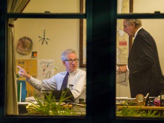 Mediator Ira Lobel, left, confers with Burlington School