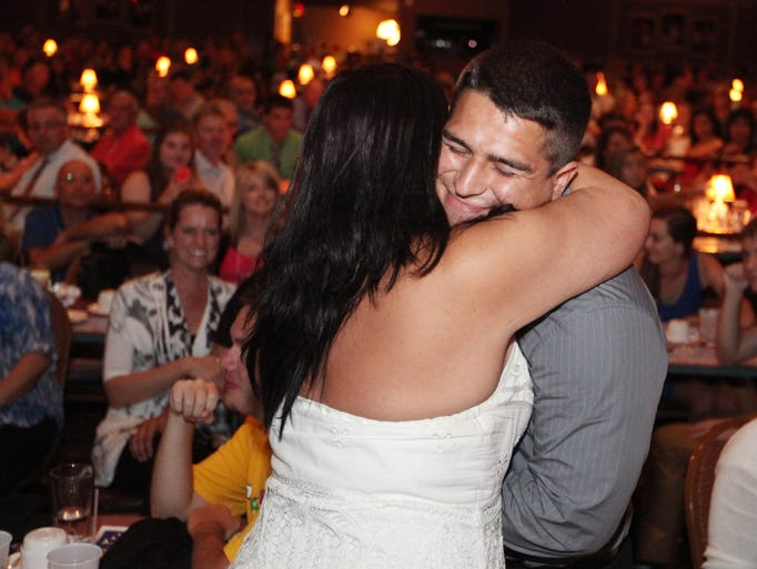 Selected as the 2014 News-Press All-Area wrestler Alejandro Lopez receives a hug from Dora Denro during the awards banquet at The Broadway Palm Theatre