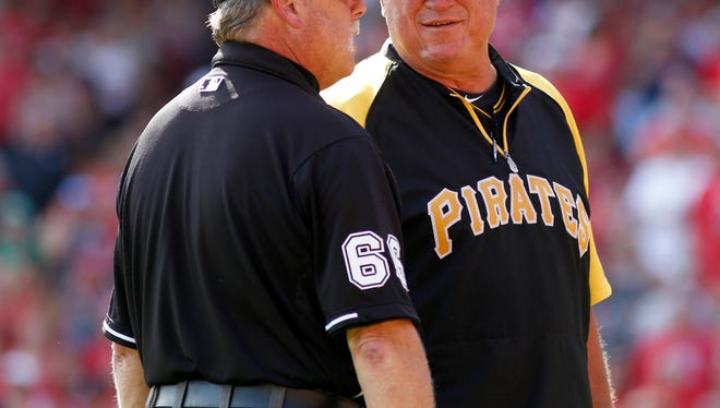 Pittsburgh Pirates manager Clint Hurdle (right) talks with third base umpire Jim Joyce.