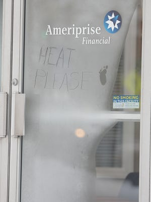 A frosty message on the door of Ameriprise Financial on East Main Street in Richmond requests heat during one of a previous cold snap.