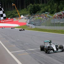 Mercedes driver Nico Rosberg of Germany crosses the finish line to win the Austrian Formula One Grand Prix.