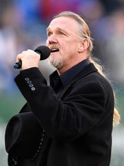 Trace Adkins sings the National Anthem before the start of the Music City Bowl at Nissan Stadium in Nashville, Tenn., Friday, Dec. 29, 2017.