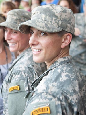 Capt. Kristen Griest, right, and 1st Lt. Shaye Haver graduate from Ranger School at Fort Benning in Georgia on Aug. 21.