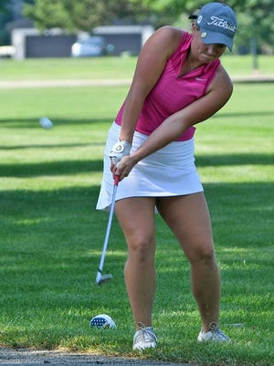 Lexi Petersen chips onto the green from near the cart path during the Women's All-City golf tournament last summer at Lake Bracken Country Club.