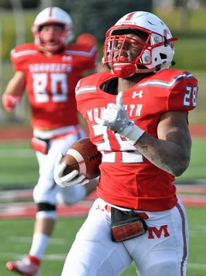 Monmouth College running back Devin Lawrence kicks it into high gear as he heads down the sideline for a touchdown on the first play of the second half during the Bronze Turkey Game against Knox College on Saturday, Nov. 9, 2019.