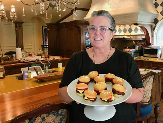 Rosie O'Donnell and the hamburger cupcakes from Aunt Mia's Gourmet Cookie and Gift Shoppe . Her chef came into the Orangeburg shop and ordered.