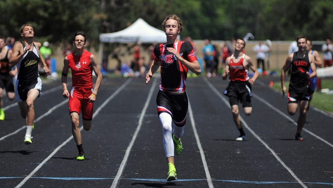 Crestview's Ben Olewiler crosses the finish line as champion in the 400 meter dash in Saturday's Division III district meet at Bucyrus.