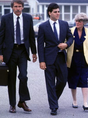 John Zaccaro Jr., center, heads into Vermont District Court for sentencing with his mother, former vice-presidential candidate Geraldine Ferraro, and attorney Charles Tetzlaff on June 16, 1988. He was pardoned Saturday by Gov. Peter Shumlin for a felony conviction of selling cocaine. He served four months in jail.