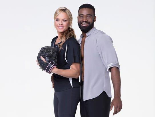 Softball pitcher Jennie Finch Daigle with her partner