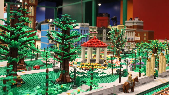 A Lego train layout and cityscape at the Cincinnati Museum Center has combined local landmarks with superheroes, including Batman and Spiderman.