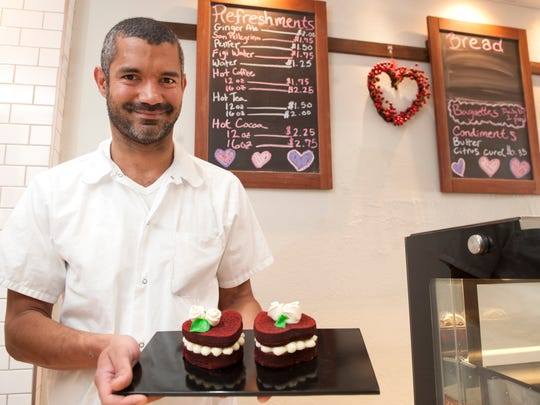 Chef Josue Negron displays Valentine's heart-shaped red velvet cakes at Dulce Artisanal Pastry in Collingswood.