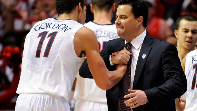 Arizona Wildcats head coach Sean Miller (right) hugs forward Aaron Gordon (11) in the second half of a men's college basketball game during the third round of the 2014 NCAA Tournament against the Gonzaga Bulldogs at Viejas Arena.