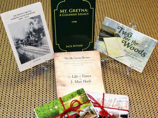 Mt. Gretna Area Historical Society President Susan Hostetter with three videos available at the society: Mt. Gretna, Pa.: The Perennial Spirit; An Excursion into Mt. Gretna's History on the Narrow Gauge Railroad; and the Pennsylvania National Guard at Mt. Gretna: 1881-1935.