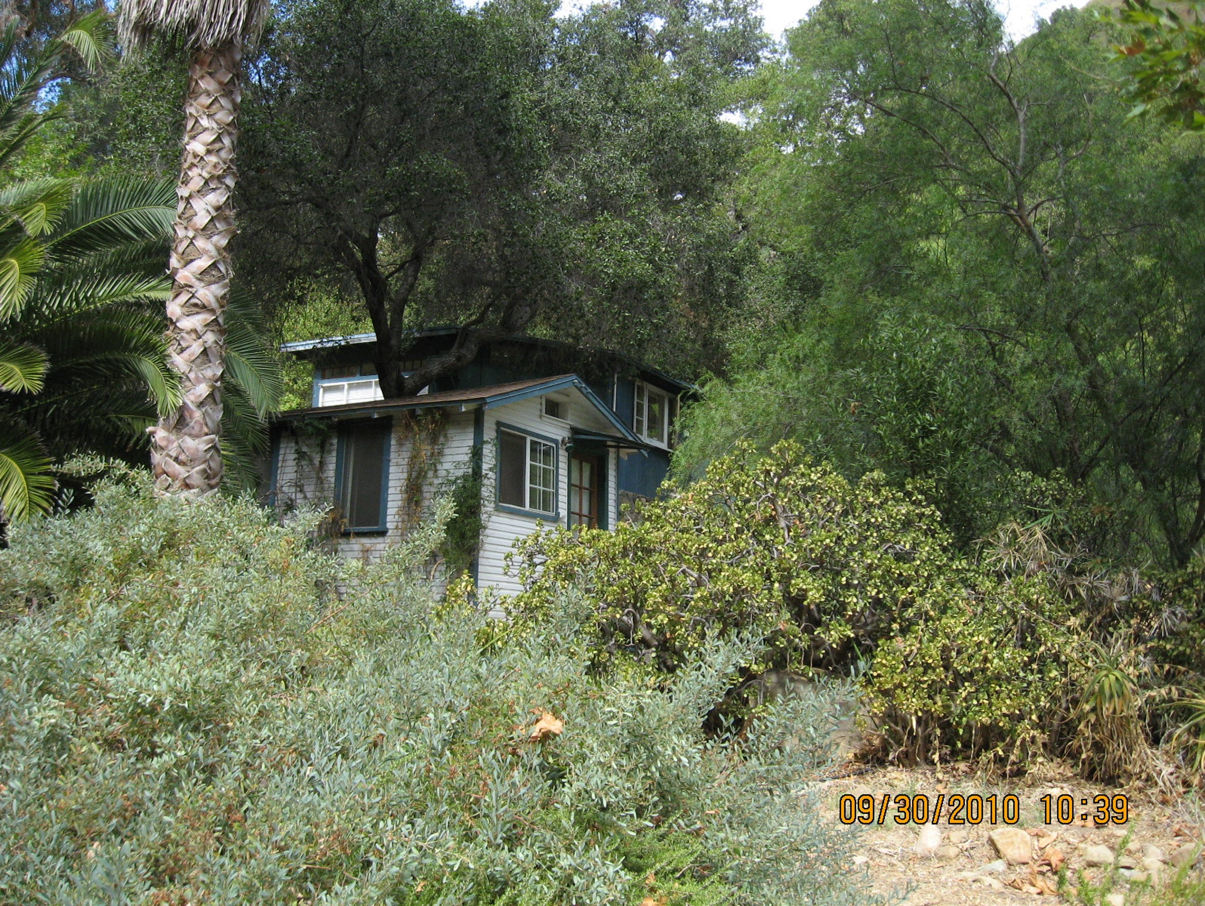 Trees shade cabins on the Matilija Hot Springs property in this photograph dated in 2010.