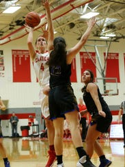 Canton senior Erin Hult (No. 4) lines up her shot in