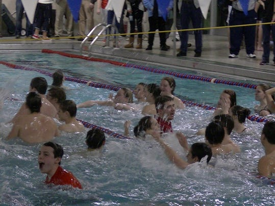 Susquehannock celebrates school's first team swimming title.