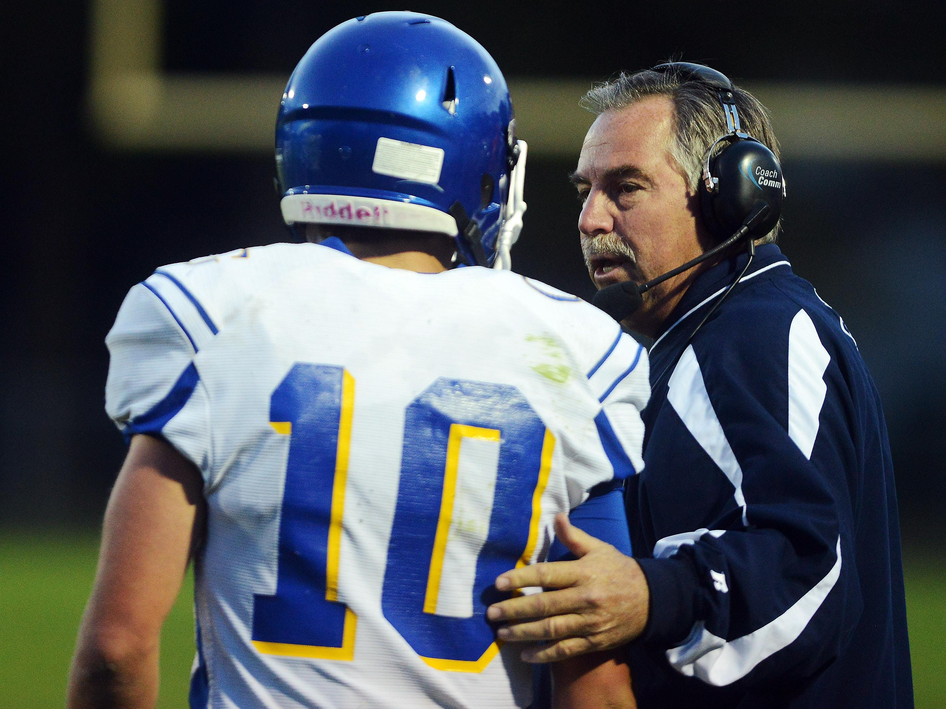 O'Gorman coach Steve Kueter talks with quarterback Luke Fritsch. Kueter matched Yankton's Max Hawk with his 284th carer win.