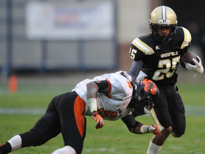 Bassfield's Curtis Mikell shakes off Calhoun City's Cartin Mcbride on a first down run.