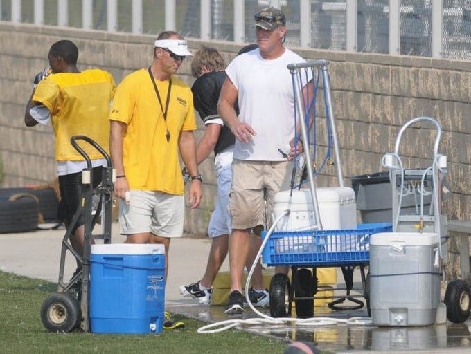 Minnesota Vikings' quarterback  Brett Favre takes a water break as he works  with players at Oak Grove High School on Wednesday morning.