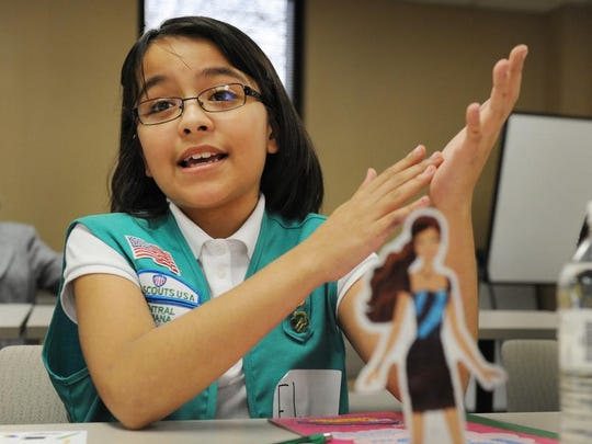 "Eylssa Merill, 9, talks about Barbie Monday March 10, 2014.  Barbie has partnered with girl Scouts of America on a patch that inspires girls to ""be anything, do everything."""