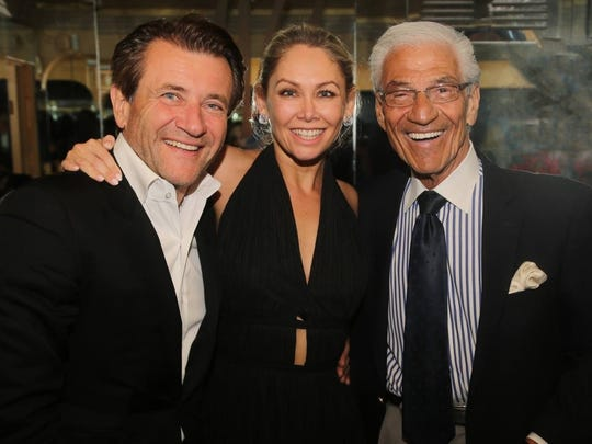 Robert Herjavec, Kym Johnson and Mel Haber, former owner of Melvyn's, pose for a photo at his restaurant.