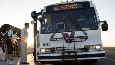 Riders board a Valley Metro Bus at the Surprise Park and Ride Lot.