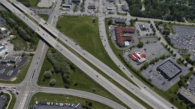 Aerial view of the I-71/ Fields Ertel exit looking due North; I-71 cuts diagonally through the photo, Fields-Ertel Road is at left, and Mason-Montgomery road is near the top of the photo.