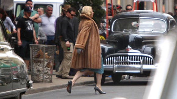 Cate Blanchett crosses Race Street by the old Shillito's store Monday