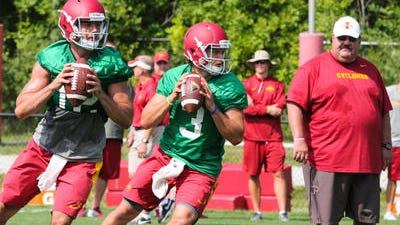 Iowa State offensive coordinator Mark Mangino, right, said the biggest improvements he's seeing with Sam Richardson , left, and Grant Rohach, are quick reads and release speeds.