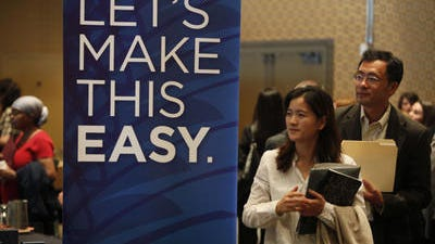 Job seekers attend a job fair at a hotel in Boston.The number of people seeking U.S. unemployment benefits surged 24,000 to a seasonally adjusted 329,000 last week, though the gain likely reflected temporary layoffs in the week before the Easter holiday.