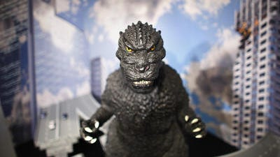 In this Monday, April 28, 2014 photo, a large size figure of Godzilla in a diorama is on display at Cheepa's gallery in Tokyo. For decades, attorneys acting on behalf of Godzillaâ??s owners, Tokyo-based Toho Co. Ltd., have amassed a string of victories, fighting counterfeiters and business titans such as Comcast and Honda along the way.
