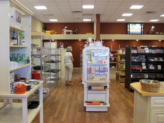 A customer shops Friday, June 8, 2018, at the going-out-of-business sale for The Good Life kitchen gadget store in North Naples.