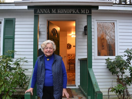 Dr. Anna Konopka stands in front of her tiny office