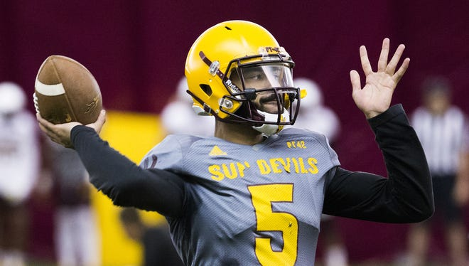 Arizona State's Manny Wilkins practices his throwing motion during practice at ASU, Friday, April 8, 2016.