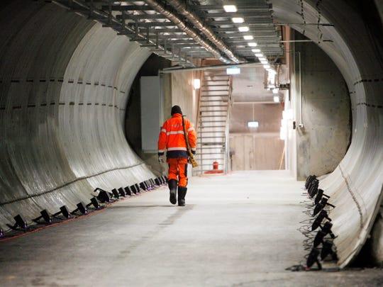 An armed guard walks through the Svalbard Global Seed Vault on Feb. 25, 2008, in Longyearbyen, Norway.