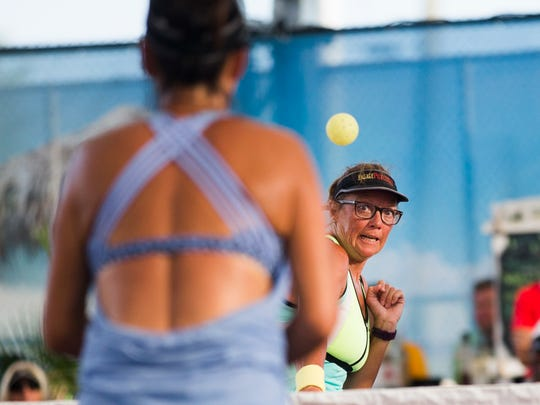 Mona Burnett looks to the ball as Jennifer Dawson hits it over the net during the Mixed Senior Pro Gold match of the U.S. Open Pickleball Championship at the East Naples Community Park in East Naples on Friday, April 28, 2017.