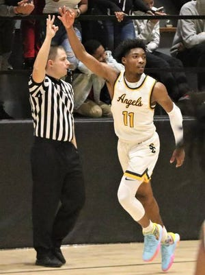 Racine St. Catherine's guard Tyrese Hunter celebrates a three-pointer against Martin Luther during a game on December 13, 2019. Curt Hogg/Now News Group