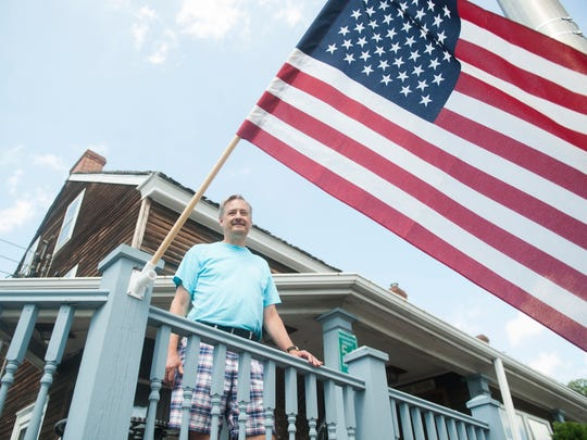 Tom Budd, owner of the Barnsboro Inn in Sewell, stands on a deck of his inn.