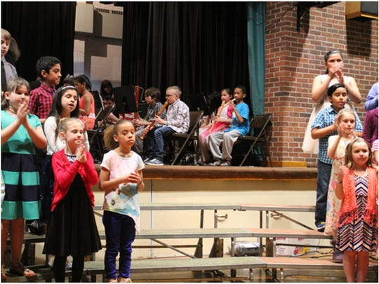 Pictured in the photo from left to right: Third grade students singing and performing to Music is Always There