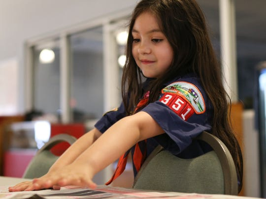 "Alexandra ""A.J."" Gardner, 6, of Middletown, helps set up for a Cub Scout meeting at the Townsend Fire Company station. Alexandra was the first girl in Delaware to join a Cub Scout group, now she's one of 4 in the pack."
