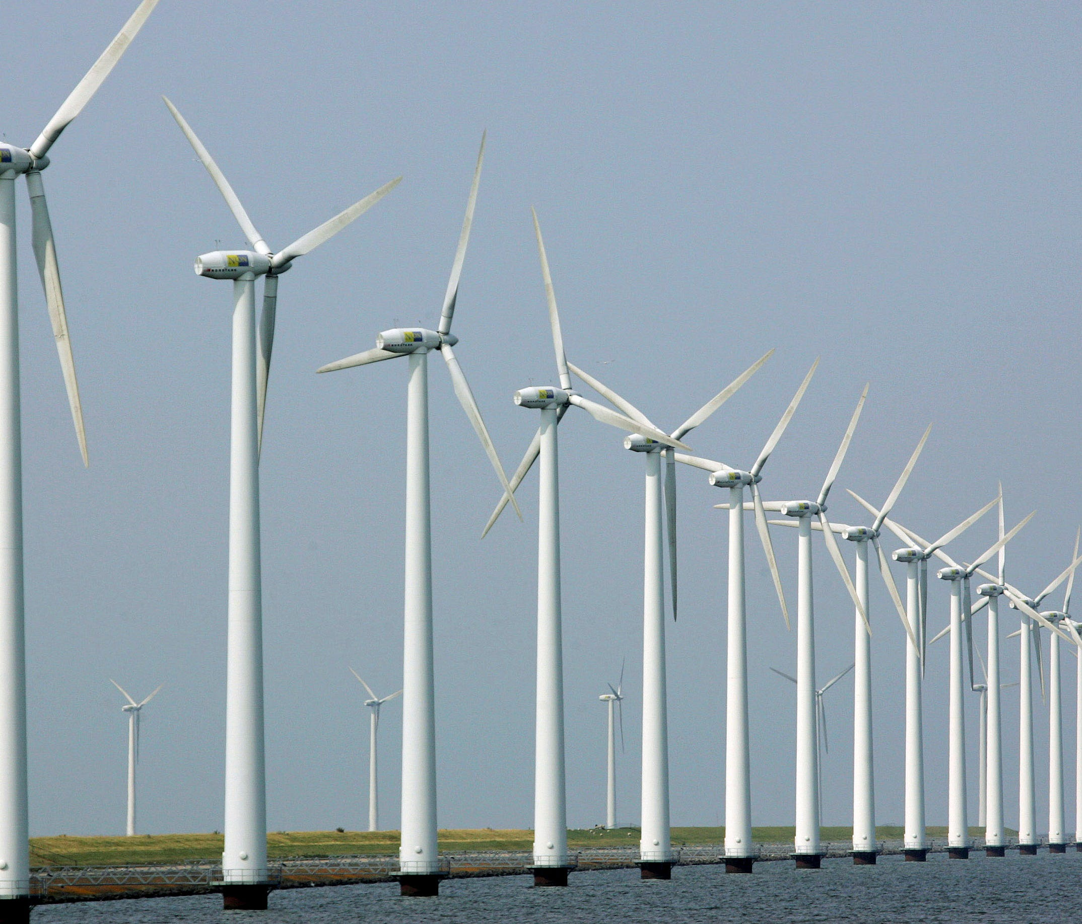 FILE - In this July 27, 2006 file photo, wind turbines stand clustered offshore in Dronten, the Netherlands.  U.S. Interior Secretary Ken Salazar will announce Wednesday, April 28, 2010, his decision whether the Cape Wind project can proceed off the