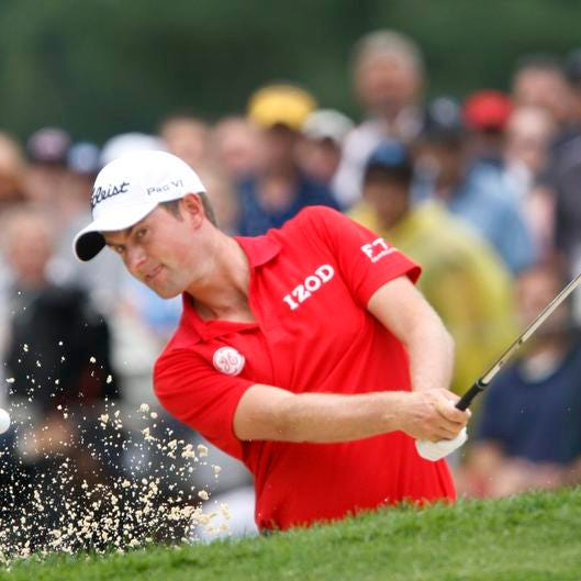 Webb Simpson blasts from bunker on No. 9 en route to his 64 on Friday at Oak Hill.