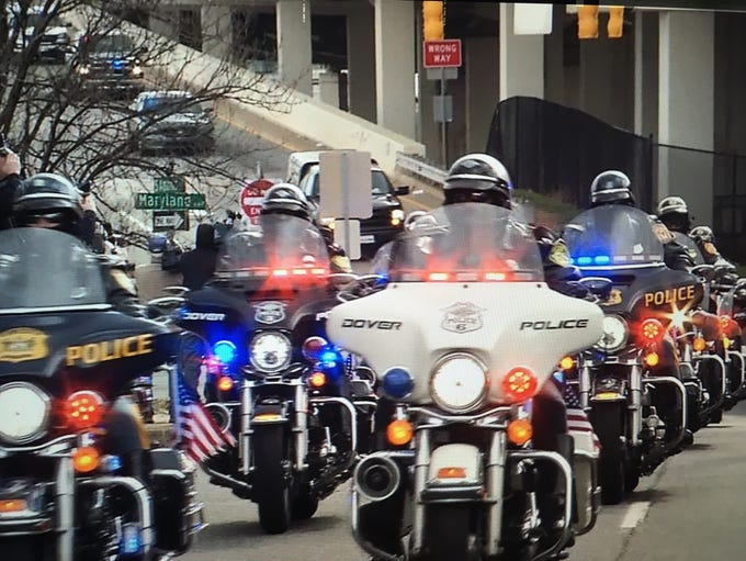 The body of corrections officer Sgt. Steven Floyd arrives