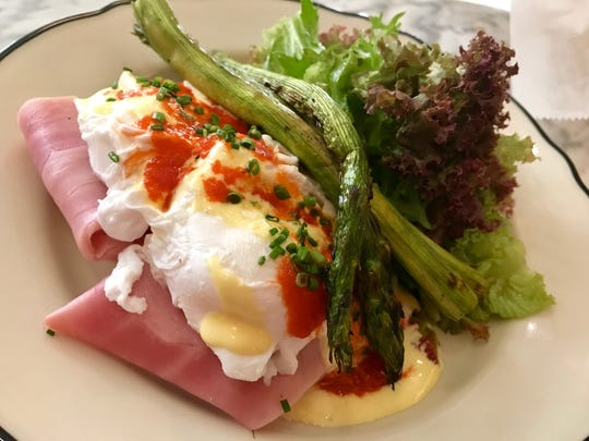 Poached eggs jamon de paris, baguette, hollandaise, pepper coulis & grilled asparagus