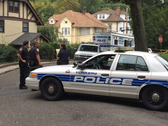 Yonkers police remain on the scene after an officer