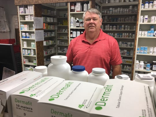 In this 2017 file photo, Kent Miles poses at Simi Valley's Home Care Pharmacy, the business he sold to his son. DEA data shows the pharmacy received more hydrocodone and oxycodone opioid pills than any other pharmacy in Ventura County from 2006 to 2012.
