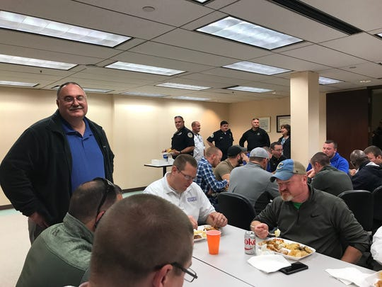 Lt. John Nevels chats with a crew of HPD detectives during his retirement luncheon Tuesday