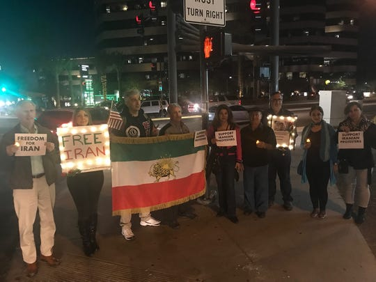 The group gathered at the intersection of 24th Street and Camelback Road in Phoenix on Jan. 4, 2018.
