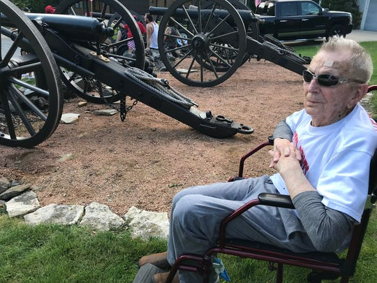 Normandy invasion veteran Chester Ignatowski fires a Civil War cannon at an Independence Day celebration in Greenfield.