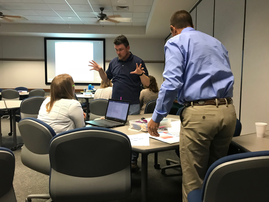 Brownwood ISD English teacher Aaron Bowen chats with fellow teachers after a breakout session he presented on teaching grammar to students at the Region 15 Service Center's 18th annual Literacy Conference.